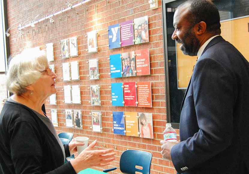 Chief Librarian speaking with patron