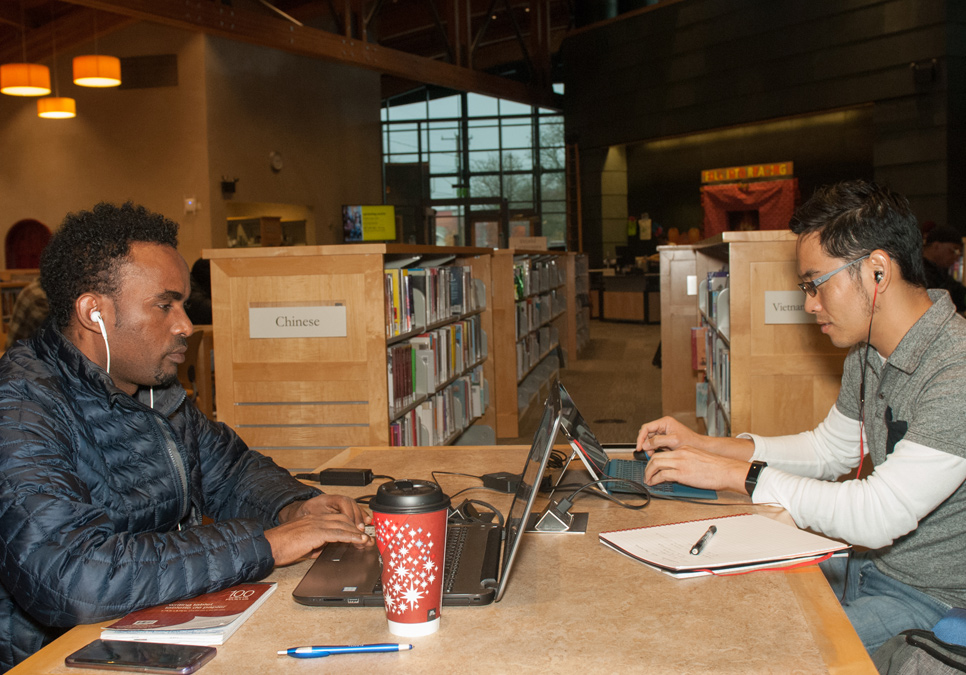 Library patrons using laptops at the Beacon Hill Branch