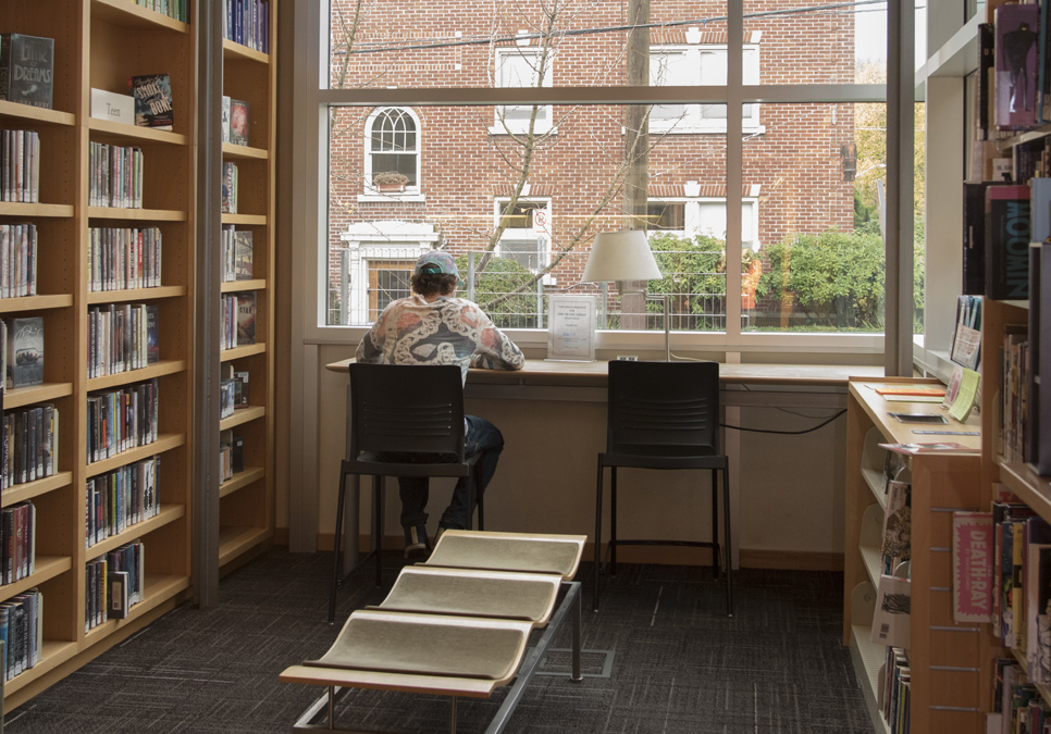 Library patron in teen area using a tablet at the Capitol Hill Branch