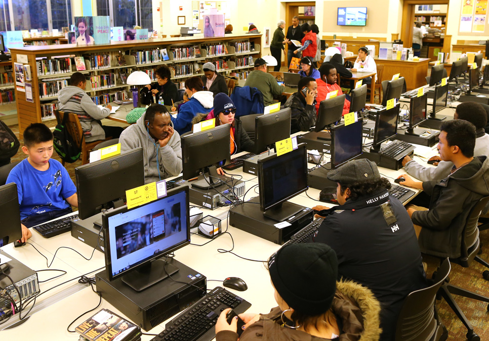 Library patrons in the public computer area at the Columbia Branch