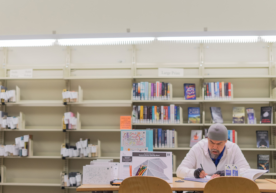 Library patron in seating area at the Delridge Branch