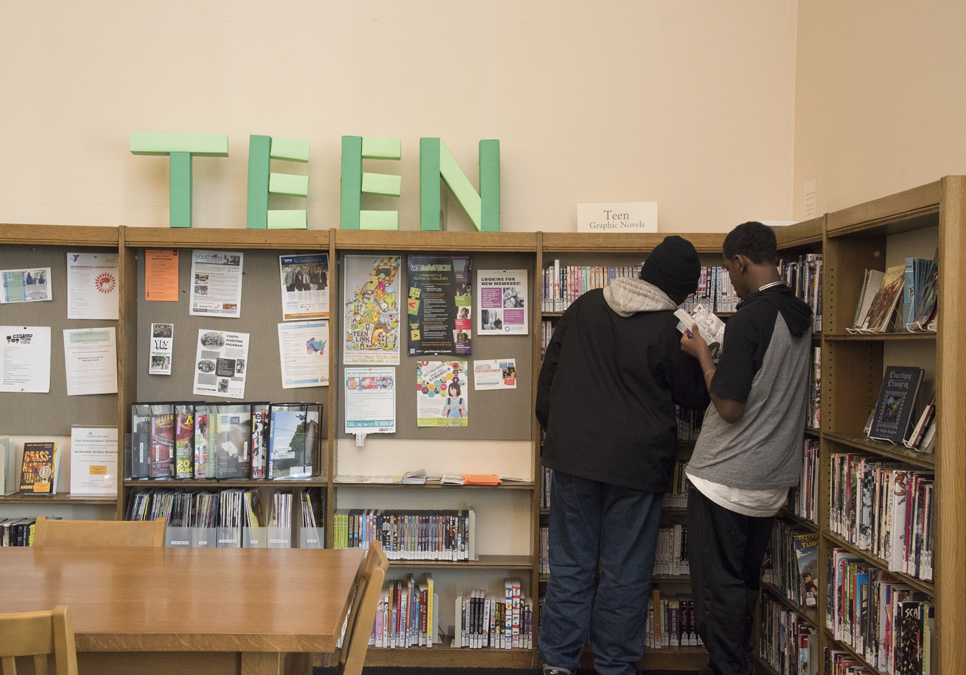 Library patrons in teen area at the Douglass-Truth Branch