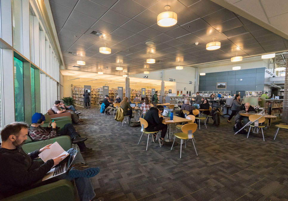 Library patrons in seating area at the Greenwood Branch
