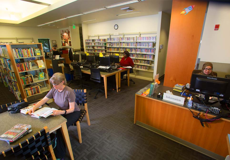 Library staff at the service desk area at the Madrona-Sally Goldmark Branch