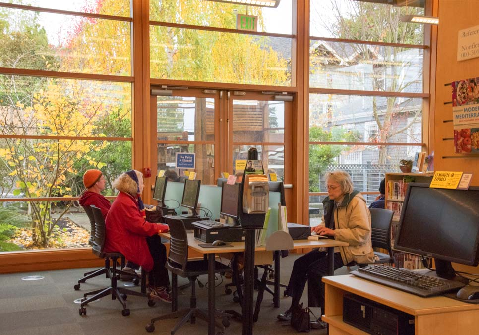 Library patrons using public computers at the Montlake Branch