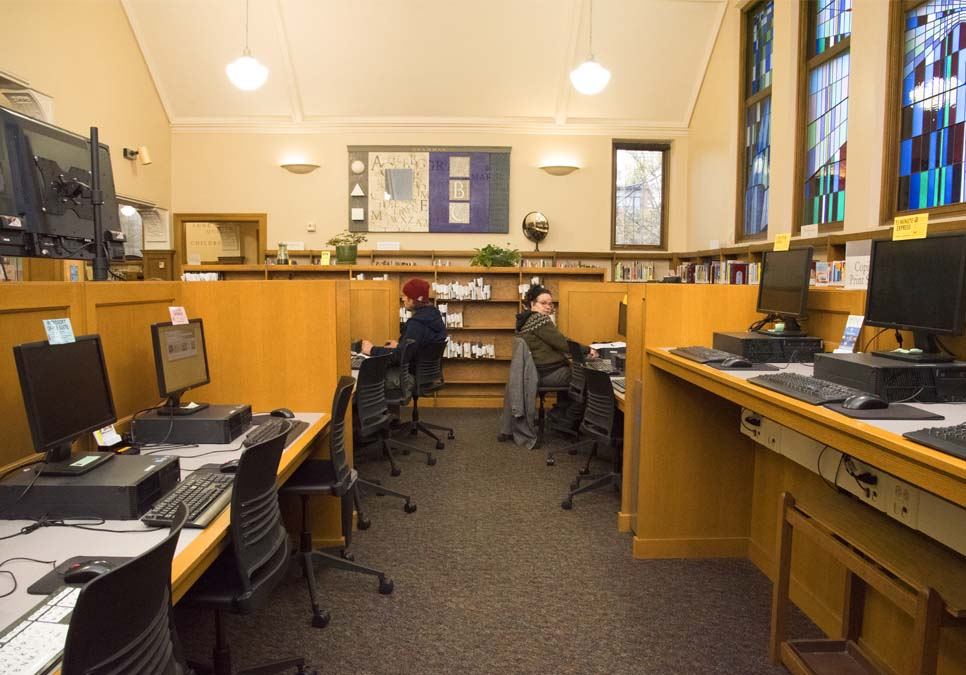 Library patrons using public computers at the Queen Anne Branch