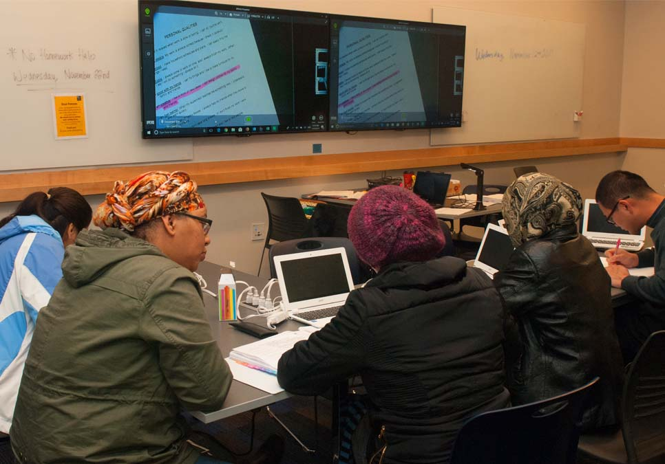 Library patrons getting homework help at the Rainier Beach Branch